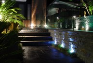 View of steps and planter boxes at night
